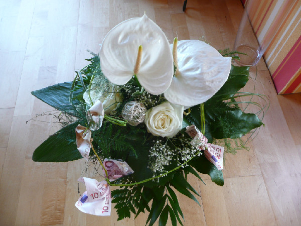 Flower arrangement with money bows